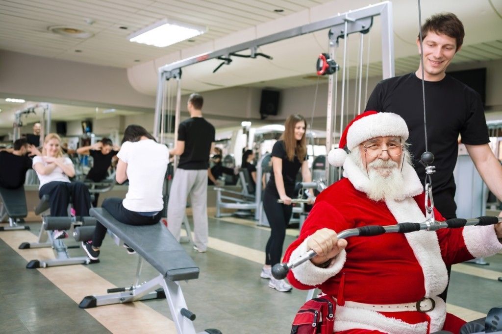 Santa Claus  doing exercises at a gym